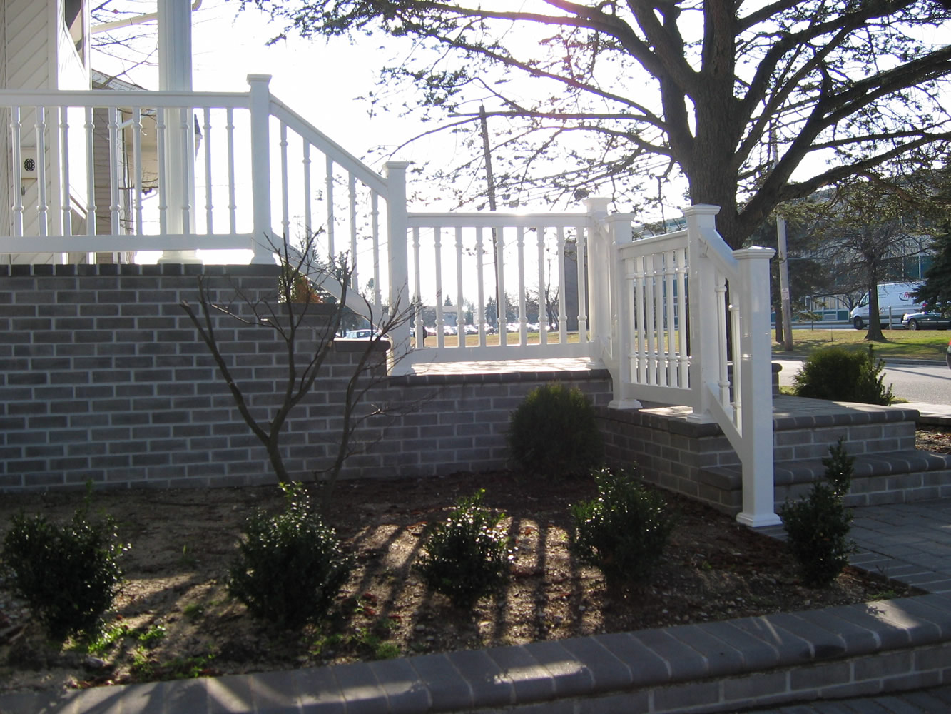 PVC Railing with T-rail Tops and Fluted Spindles