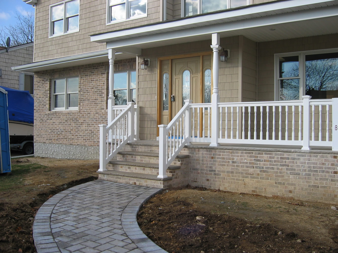 Reno Style PVC Railing with T-rail Tops and Heritage Porch Posts