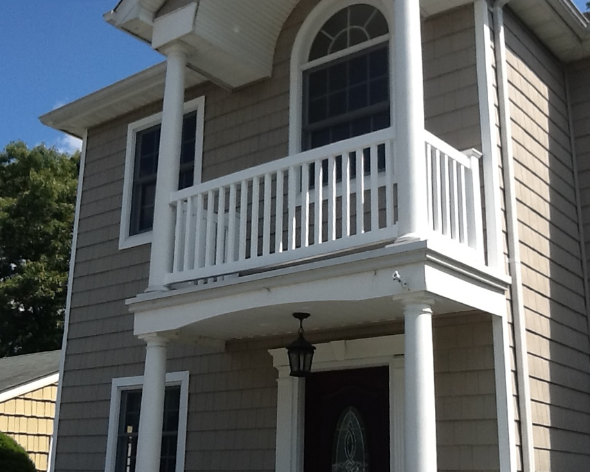 Phoenix Style PVC Railing Installed on Top of Portico between Round Columns