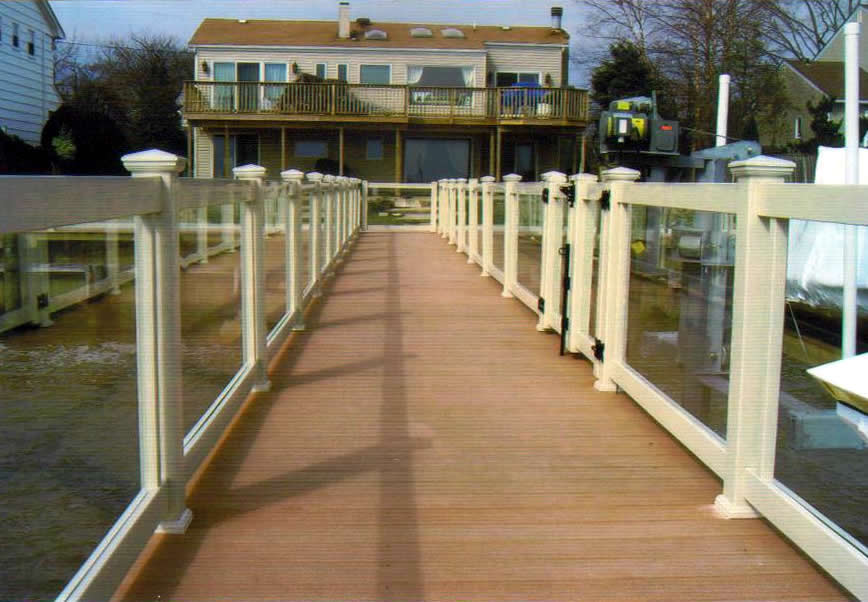Glass Rail Installed on Dock with Tan PVC